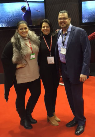 On the show floor (from left to right): Keli Snyder Jenkins; Yvonne DeFrancesco, Executive Vice President, Air Age Media; Mike Jenkins, President & CEO, Traxxas.