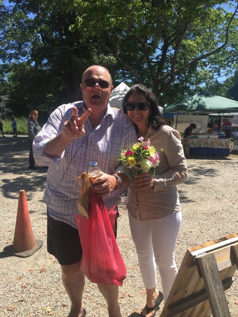 Sales Executive, Ben Halladay, and Publisher, Yvonne DeFrancesco, enjoy organic flowers and local baked bread.